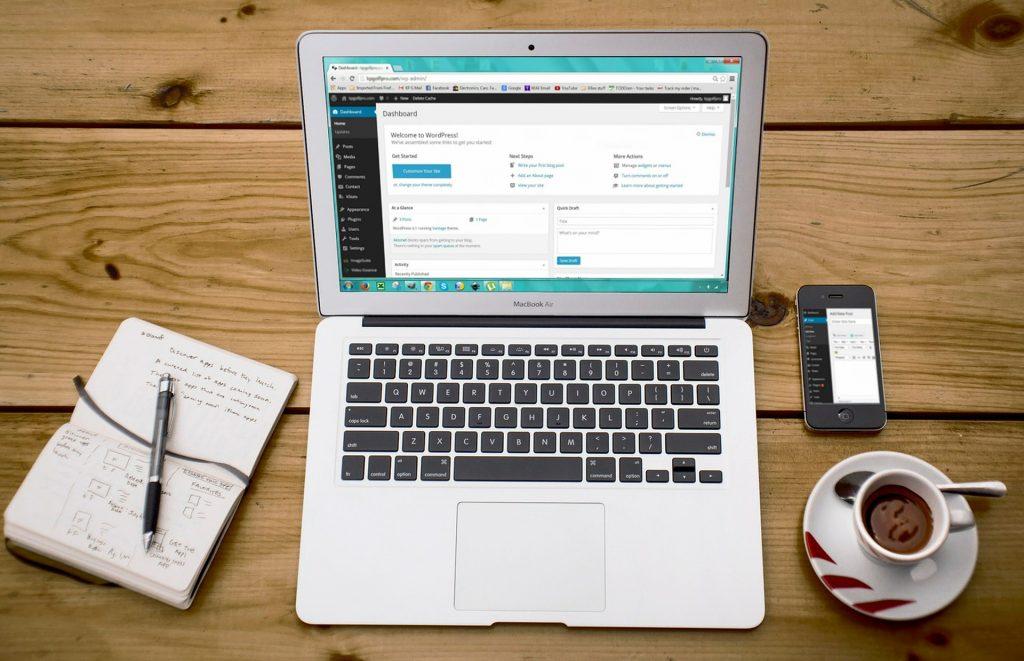laptop with website platform on screen